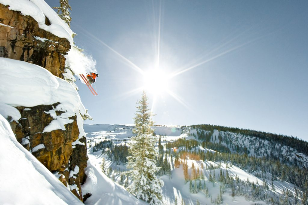 John Nicoletta and Kate Olson skiing powder and jumping cliffs at Snowmass, Aspen/Snowmass, Colorado. Local Adventure Photographer Captures Locals at Play.