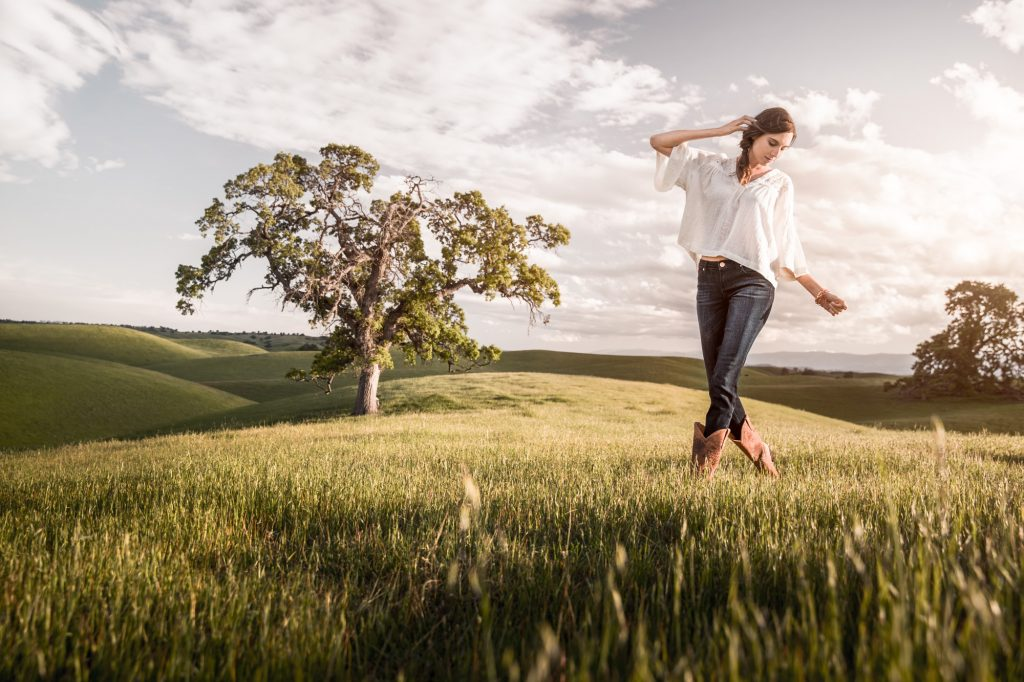 The Young Woman in this Photograph, Taken on Wide Open Ranchland, Moves Comfortably and Confidently in Western Boots and Lifestyle Apparel.