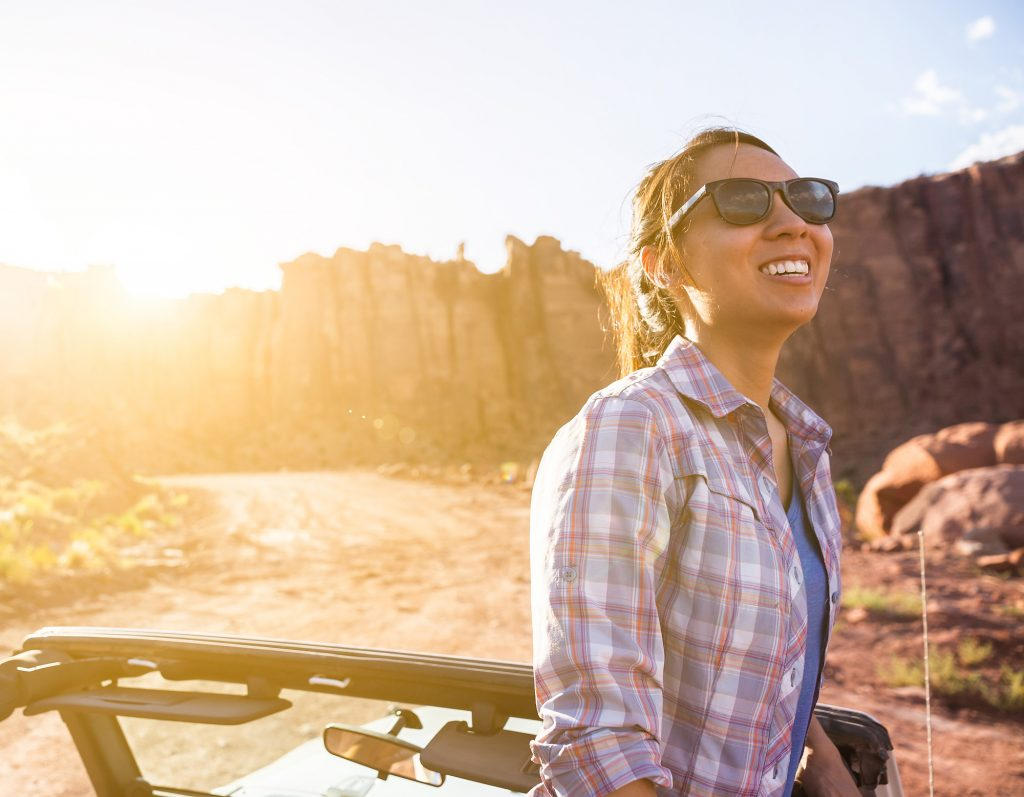 Red Rocks in the Utah Desert Make for Beautiful and Dramatic Images. This Woman Looks Out from the Top of Her Jeep Tour in a Breathtaking Canyon.