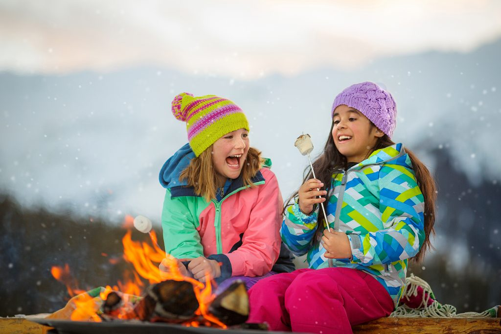 Two Young Girls Enjoy an Open Campfire and S'mores in the Rocky Mountains Near Aspen. This Lively Photograph was Shot as Part of a Tourism Campaign for Snowmass Village, CO.