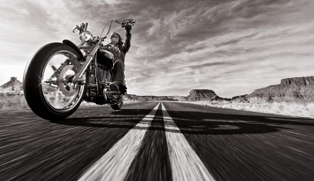 Motorcycle riding and rock climbing along Route 128 and the Fisher Towers near Moab, Utah. This area is near Canyonlands and Arches National Parks, and features dramatic sandstone towers rising above the Colorado River.