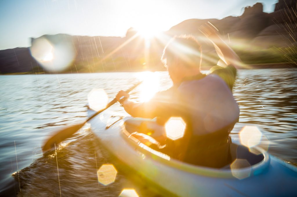 This Photograph Captures the Tranquility and Peace of Paddling on the Slow Waters of the Colorado River as the Sun Sets in the Background.