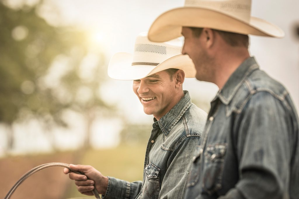 This Authentic Photograph of Western Cowboy Lifestyle shows Two Men Passing the Time at a Roping Competition. Photographer/Director Tyler Stableford took this Shot as Part of a Campaign for Wrangler Jeans.