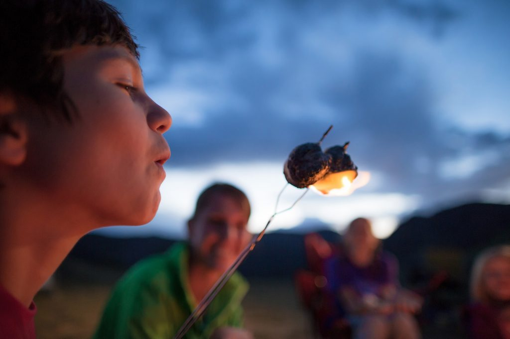 Nothing Says Outdoor Lifestyle Like Kids Around a Campfire Enjoying S'Mores. This Photo Was Featured on Cabela's Camping Cover.