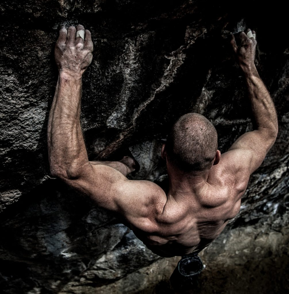 A Gritty Image of Rock Climber Bouldering. Photographing Climbers Doesn't Look More Real Than This.