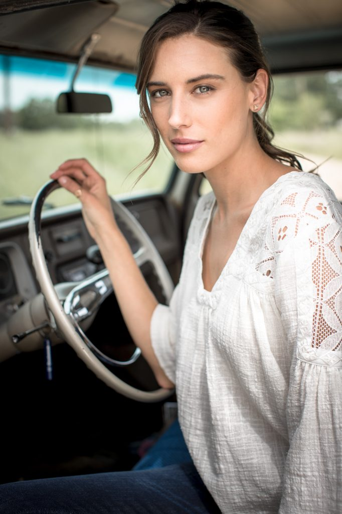 This Graceful Portrait of a Pretty Girl at the Wheel of a Vintage Truck Highlights the Lifestyle of Many Who Wear Western Style Apparel.